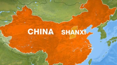 Scores trapped as China mine floods