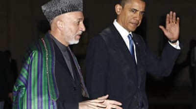 Obama urges progress in Afghanistan
