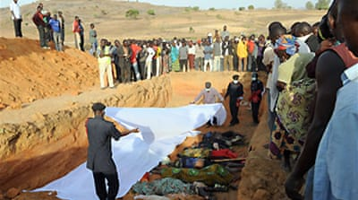 Nigerians bury massacre victims