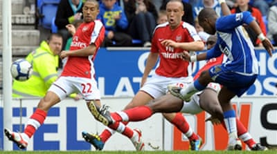 Wigan shoot down last Arsenal hope
