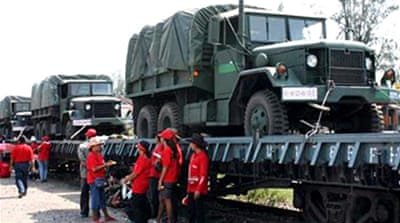 Thai red shirts release army train
