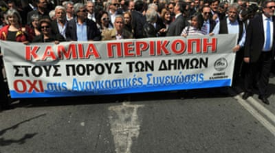 Greeks protest over cut backs