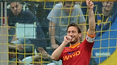Totti puts Roma back on top