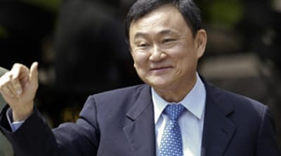Thaksin dismisses arrest warrant