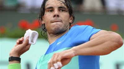 Seamless Nadal subdues Hewitt
