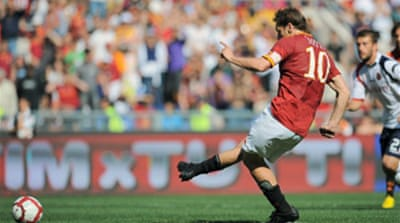 Roma take title to last day