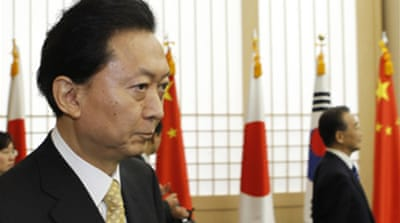 Japan PM urged to quit over base