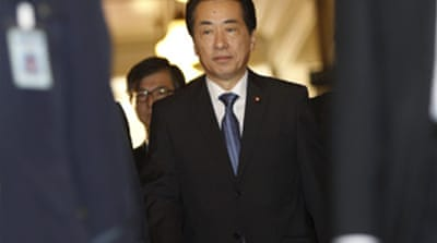 New Japan PM vows to reduce debt