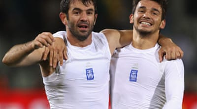 Greece get first World Cup win