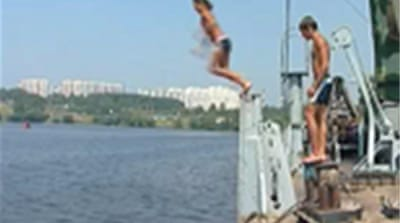 Russians drown fleeing record heat