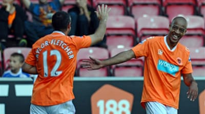 Blackpool hit four to go top