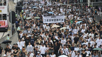 Hong Kong rallies for bus victims
