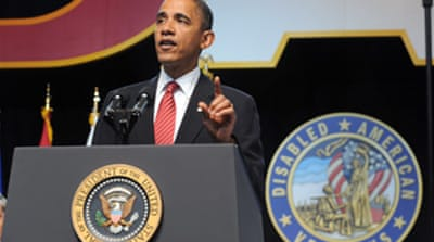 Obama defends his 'good war'