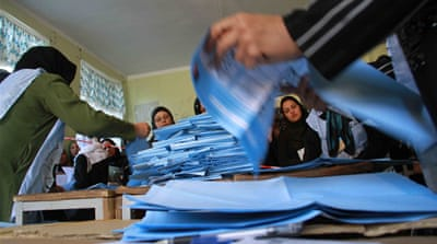 Afghans brave attacks to vote