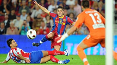 Villa gives Barca slim win