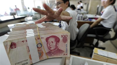 China rebuffs US criticism of yuan