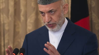 Karzai to pursue talks with Taliban