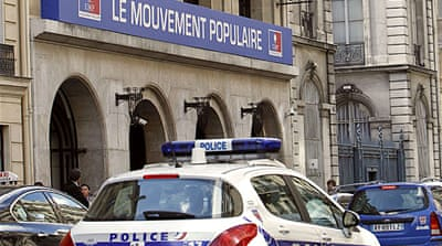 Police search Sarkozy's party base