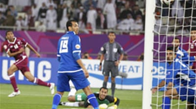 Qatar join Uzbeks in quarter-finals