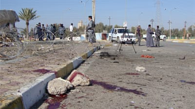Suicide bomber kills scores in Iraq