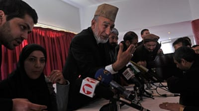 Karzai agrees to open parliament