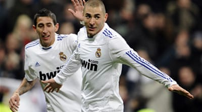 Benzema keeps Real in the hunt