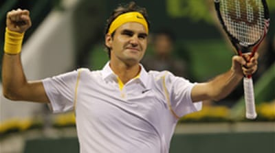 Federer warms up with Qatar title