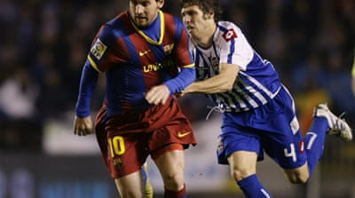 Messi guides Barca to crash Depor