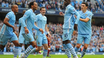 Man City hit four to shoot to top of table