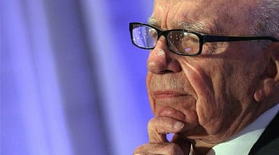 Murdoch says 'no excuses' over phone hacking