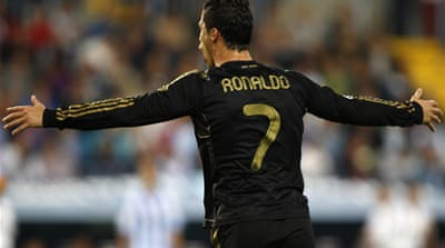 Ronaldo fires Real top, Barca held by Sevilla