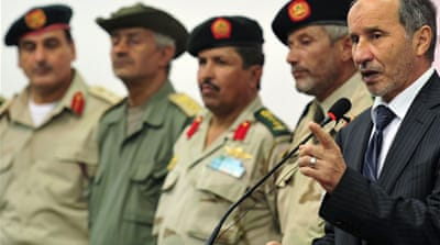 Libya's NTC orders probe into Gaddafi killing