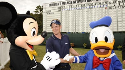 An animated Luke Donald celebrates Disney win