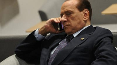 Protesters ask Berlusconi to quit