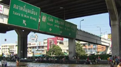 Bangkok floodwaters force difficult decision