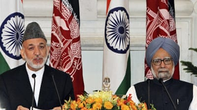 Karzai seals strategic pact with India