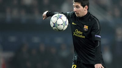 Inspired Messi hat-trick takes Barca through