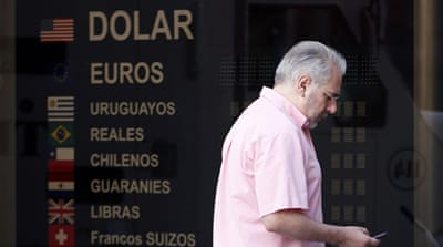 Argentina toughens rules on dollar trades
