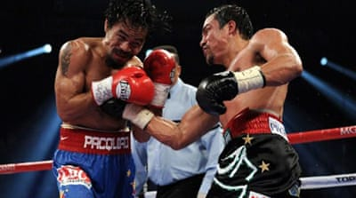 Pacquiao edges old foe Marquez in thriller