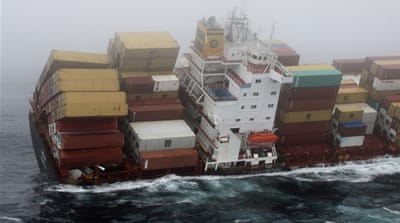 Ship stranded on NZ reef 'nearly breaking up'