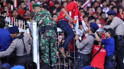Fans die in Indonesia football stampede