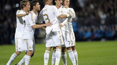 Real Madrid reach knockout phase