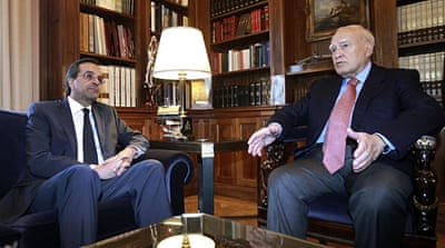 Greek president begins talks to end crisis