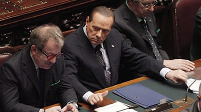 Budget vote puts squeeze on Berlusconi