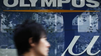 Ex-CEO tells Olympus board to step down