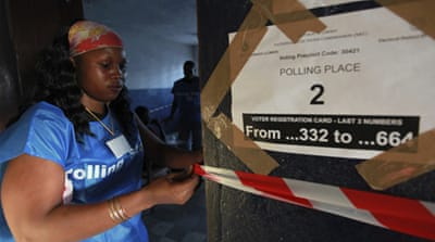 Liberians vote amid tension
