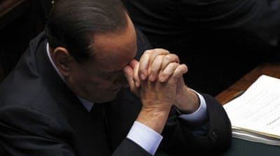 Berlusconi vows to remain in political arena