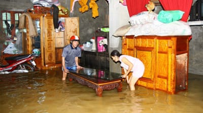 At least 100 people dead in Vietnam flooding
