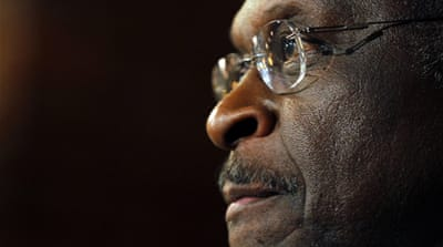 Cain 'reassessing' US presidential run