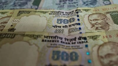 Indian rupee hits record low against dollar